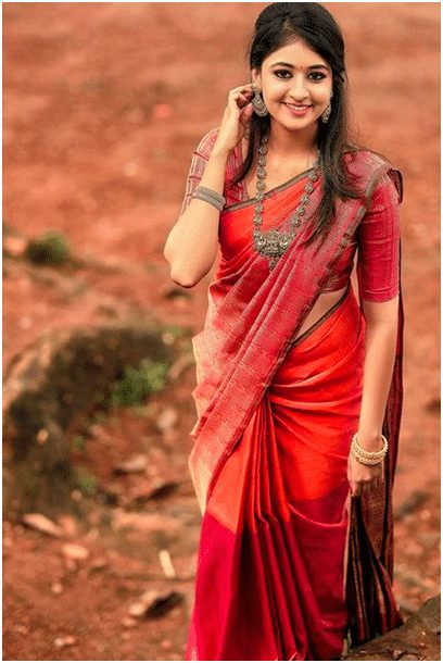 Red with blue saree
